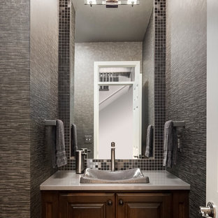 Example of a small transitional gray tile and metal tile bathroom design in Kansas City with dark wood cabinets, engineered quartz countertops, gray walls, a vessel sink and raised-panel cabinets
