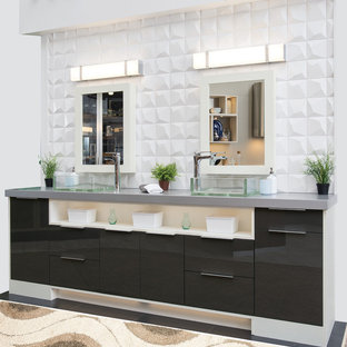 Inspiration for a mid-sized contemporary master bathroom in Birmingham with flat-panel cabinets, black cabinets, white tile, stone tile, stainless steel benchtops, black floor, white walls, a vessel sink and grey benchtops.