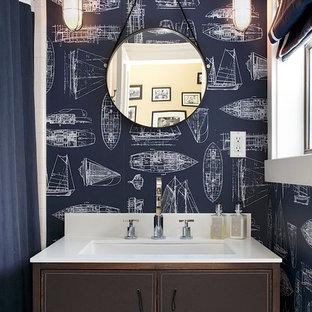 На фото: ванные комнаты в современном стиле с плоскими фасадами, коричневыми фасадами, разноцветными стенами и белой столешницей