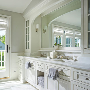 Example of a classic master bathroom design in Burlington with white cabinets, gray walls, an undermount sink, recessed-panel cabinets, marble countertops and white countertops