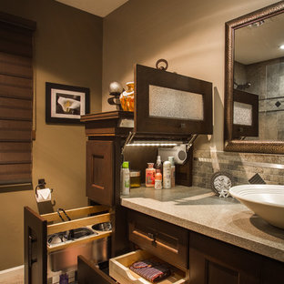 Transitional bathroom photo in Omaha with a vessel sink, recessed-panel cabinets, dark wood cabinets and brown walls