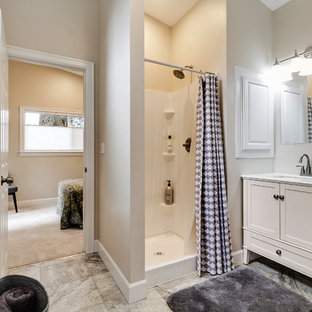Small contemporary family bathroom in Portland with shaker cabinets, white cabinets, an alcove shower, a two-piece toilet, beige tiles, beige walls, lino flooring, a submerged sink, engineered stone worktops, grey floors and a shower curtain.