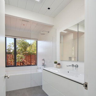 Inspiration for a large contemporary 3/4 porcelain floor, gray floor, single-sink and shiplap ceiling bathroom remodel in San Francisco with flat-panel cabinets, white cabinets, white walls, an integrated sink, white countertops and a floating vanity