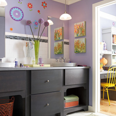 Bathroom - mid-sized eclectic kids' subway tile ceramic tile bathroom idea in Indianapolis with a vessel sink, flat-panel cabinets, black cabinets, purple walls and limestone countertops