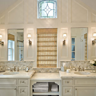 Bathroom - large traditional master white tile and marble tile marble floor bathroom idea in New York with an undermount sink, recessed-panel cabinets, white cabinets, marble countertops, gray walls and white countertops