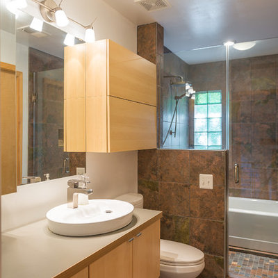 Example of a trendy brown tile bathroom design in DC Metro with a vessel sink, flat-panel cabinets, light wood cabinets and a one-piece toilet