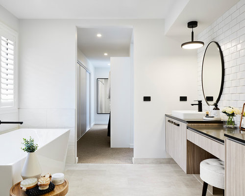 Design ideas for a modern master bathroom in Melbourne with flat-panel  cabinets, beige