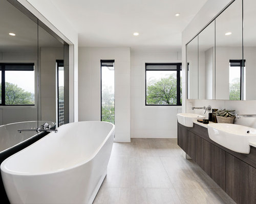 Inspiration For A Modern Master Bathroom In Sydney With Flat Panel  Cabinets, Dark Wood