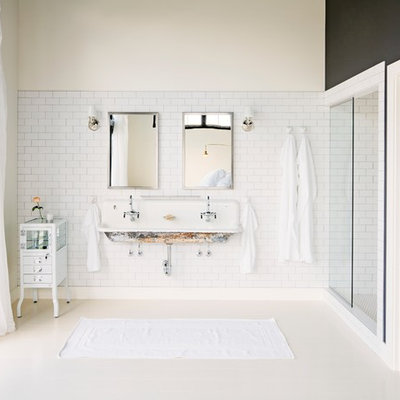 Bathroom - industrial white tile and subway tile bathroom idea in Portland with a trough sink and multicolored walls