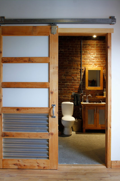 Industrial Bathroom by Esther Hershcovich