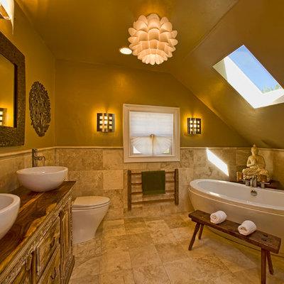 Trendy freestanding bathtub photo in Sacramento with a vessel sink