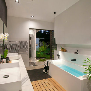 Inspiration for a modern master bathroom in Sunshine Coast with a freestanding tub, black tile, mosaic tile, grey walls and a vessel sink.