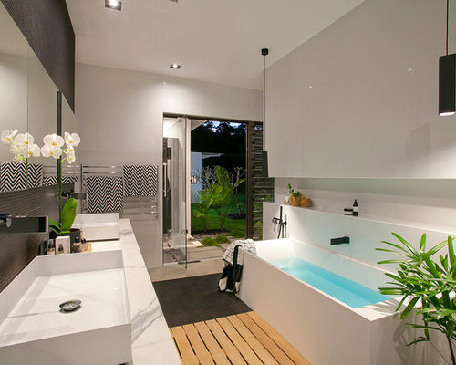Inspiration For A Modern Master Bathroom In Sunshine Coast With A  Freestanding Tub, Black Tile