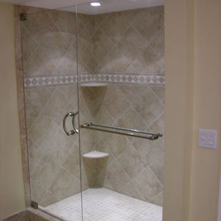 Example of a mid-sized tuscan master porcelain tile and beige tile porcelain tile alcove shower design in Tampa with beige walls