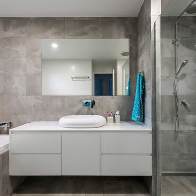 Example of a trendy master gray tile gray floor bathroom design in Gold Coast - Tweed with flat-panel cabinets, white cabinets, gray walls and a vessel sink