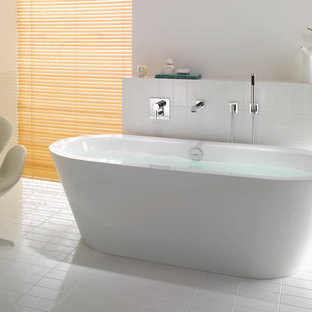 Example of a trendy master white tile and porcelain tile porcelain tile and white floor freestanding bathtub design in Miami with white walls
