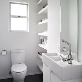 Small 1960s bathroom photo in San Francisco with a vessel sink, flat-panel cabinets, white cabinets, a two-piece toilet and white walls