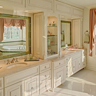 Example of a huge classic master beige tile and porcelain tile porcelain tile bathroom design in Newark with an undermount sink, raised-panel cabinets, beige cabinets, onyx countertops, a one-piece toilet and beige walls