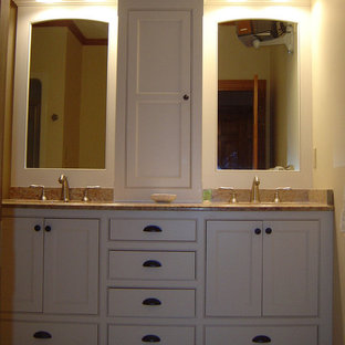 Photo of a rustic bathroom in Portland Maine with white cabinets and granite worktops.