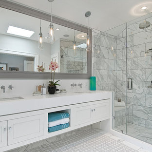 Alcove shower - mid-sized transitional 3/4 white tile and stone tile marble floor alcove shower idea in San Francisco with an undermount sink, shaker cabinets, white cabinets, quartz countertops and white walls
