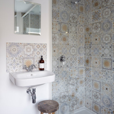 Bathroom - scandinavian 3/4 multicolored tile and mosaic tile gray floor and single-sink bathroom idea with white walls and a wall-mount sink