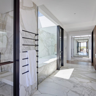 Design ideas for a modern bathroom in Sydney with flat-panel cabinets, dark wood cabinets, an undermount tub, white tile, stone slab, white walls, an integrated sink, white floor and white benchtops.