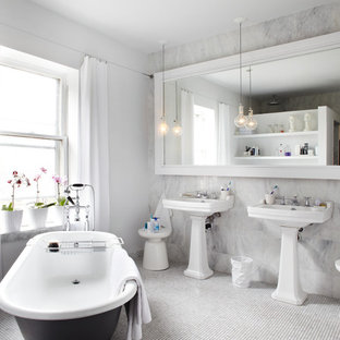 Design ideas for a contemporary bathroom in Toronto with a claw-foot bath and a pedestal sink.