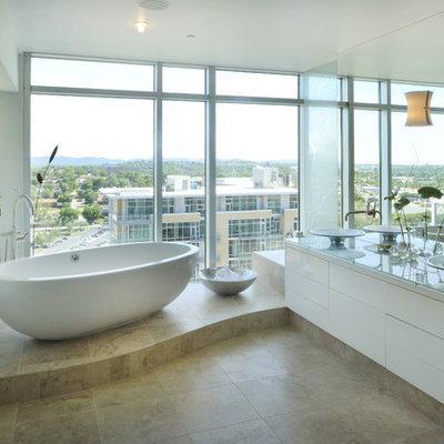 Example of a trendy freestanding bathtub design in Nashville with a vessel sink