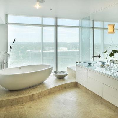 Trendy freestanding bathtub photo in Nashville with a vessel sink