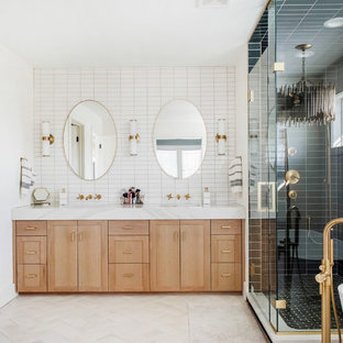Inspiration for a large transitional master green tile and ceramic tile ceramic tile and beige floor bathroom remodel in Denver with light wood cabinets, white walls, a hinged shower door and white countertops