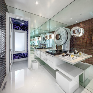 Bathroom - contemporary brown tile bathroom idea in Los Angeles with a vessel sink, flat-panel cabinets, white cabinets and brown walls