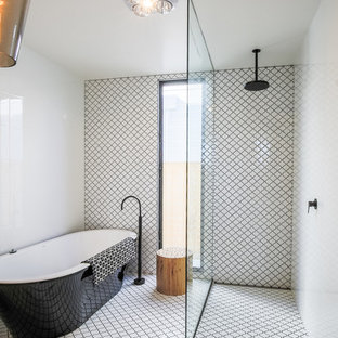 This is an example of an eclectic master bathroom in Other with a freestanding tub, an open shower, black and white tile, multi-coloured walls and multi-coloured floor.