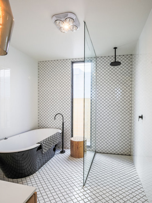 This Is An Example Of Eclectic Master Bathroom In Other With A Freestanding Tub