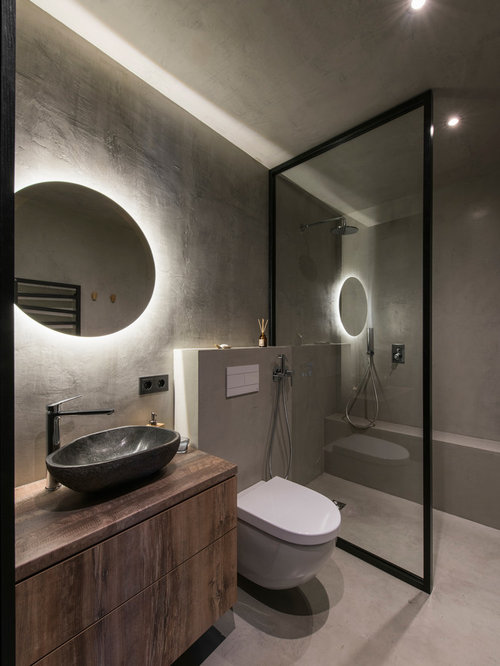 badezimmer mit braunen schr nken und zementfliesen ideen design bilder houzz. Black Bedroom Furniture Sets. Home Design Ideas
