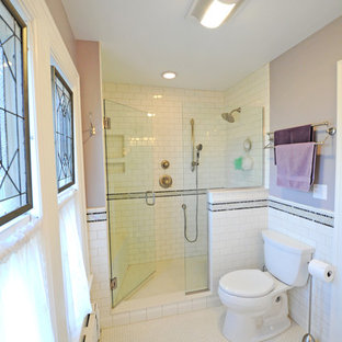 Alcove shower - mid-sized contemporary master white tile and porcelain tile porcelain tile and white floor alcove shower idea in Cleveland with a two-piece toilet, beige walls, an integrated sink and a hinged shower door