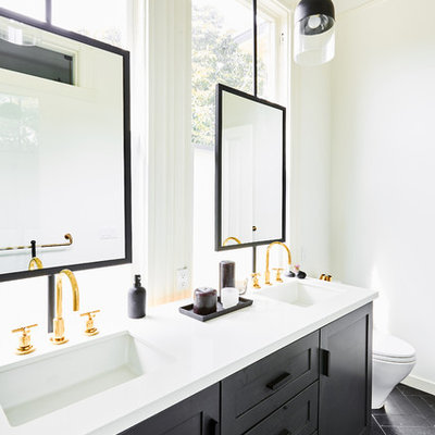 Inspiration for a mid-sized transitional master white tile and porcelain tile marble floor and black floor bathroom remodel in San Francisco with shaker cabinets, black cabinets, a one-piece toilet, white walls, an undermount sink, quartz countertops and white countertops