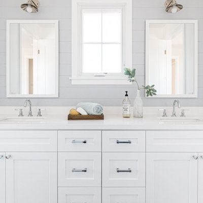 Inspiration for a cottage gray floor and double-sink bathroom remodel in Los Angeles with shaker cabinets, white cabinets, gray walls, an undermount sink and white countertops