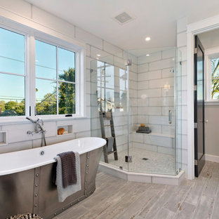 Inspiration for a farmhouse master white tile gray floor bathroom remodel in Los Angeles with gray walls and a hinged shower door
