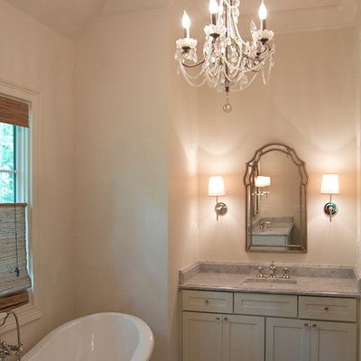 Example of a mid-sized classic master gray tile and stone tile marble floor bathroom design in Birmingham with an undermount sink, shaker cabinets, white cabinets, marble countertops, a two-piece toilet and white walls