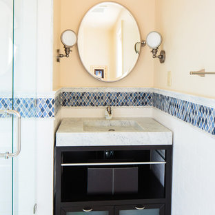 Bathroom - traditional bathroom idea in Other with a console sink