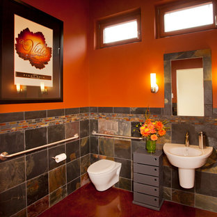 Inspiration for a contemporary multicolored tile and slate tile bathroom remodel in Portland with a wall-mount sink, a wall-mount toilet and orange walls