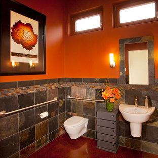 Inspiration för moderna badrum, med ett väggmonterat handfat, en vägghängd toalettstol, flerfärgad kakel, orange väggar och skifferkakel