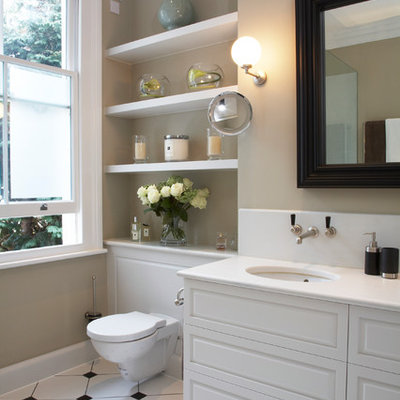 Mid-sized elegant bathroom photo in London with an undermount sink