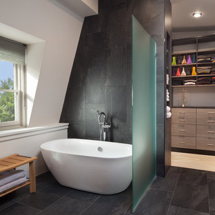 Example of a large trendy master gray tile and porcelain tile porcelain floor and gray floor freestanding bathtub design in DC Metro with white walls and engineered quartz countertops