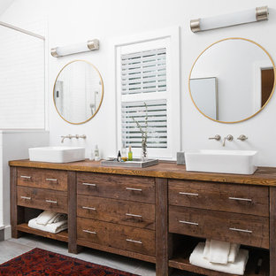 Inspiration for a mid-sized timeless master white tile and subway tile porcelain floor and gray floor alcove shower remodel in Boston with dark wood cabinets, white walls, a vessel sink, wood countertops, a hinged shower door, furniture-like cabinets and brown countertops