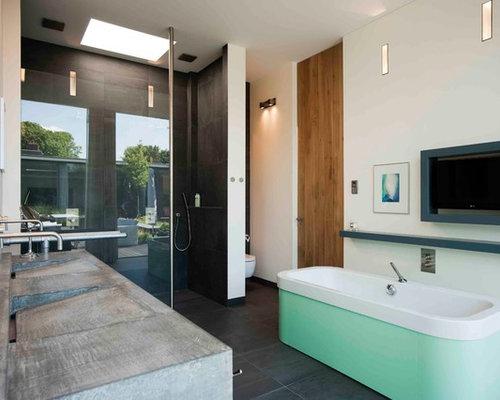 Badezimmer mit beton waschbecken waschtisch und gr nen schr nken ideen design bilder houzz - Wandfarbe beton ...