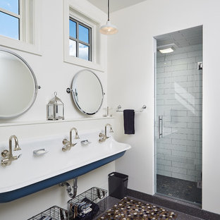 Example of a coastal kids' white tile and ceramic tile alcove shower design in Grand Rapids with white walls, a trough sink and a hinged shower door