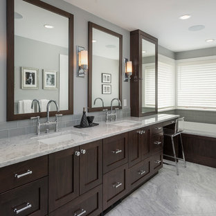 Inspiration for a contemporary bathroom remodel in Seattle with shaker cabinets and marble countertops