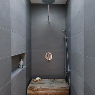 Design ideas for an industrial bathroom in Seattle with an alcove shower and gray tile.