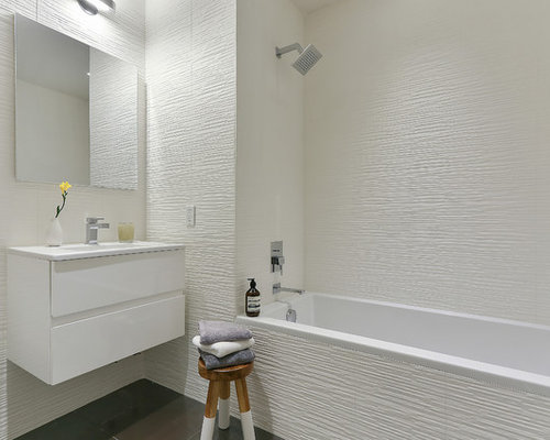 Contemporary white tile bathroom idea in New York with flat-panel cabinets  and white cabinets